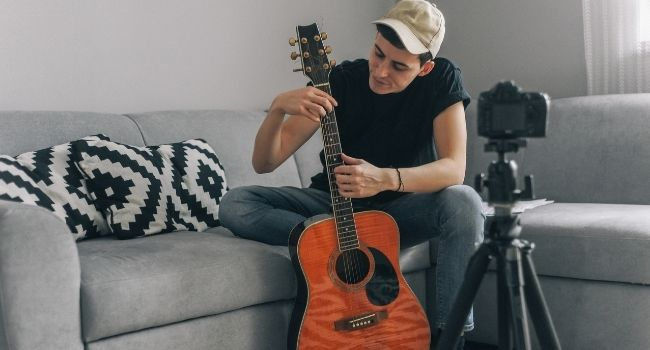 Image of a person showing guitar